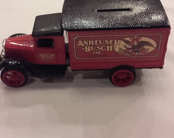 Vintage 1992 Ertl Die Cast Coin Bank. This Bank is a 1931 Hawkeye Delivery Truck for Anheuser Bush.  This Coin bank has the key.  No box.