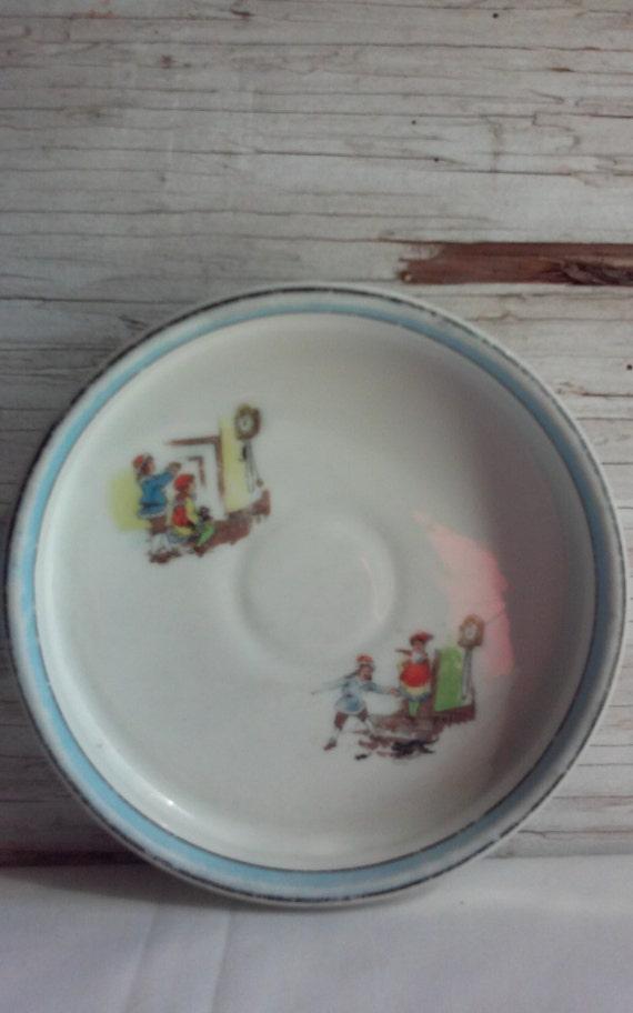 Vintage 1940s Noritake Nursery Rhyme Child's Plate. This Plate is Hickory Dickory Dock The Mouse Ran Up The Clock.  Nice used condition.