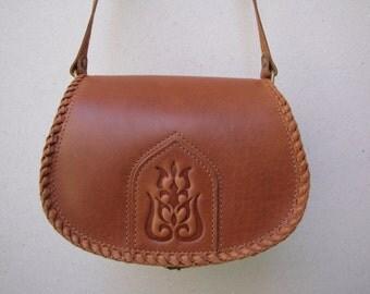 chest nut leather bag,brown bag, medium sized leather bag, long shoulder strap,embossed decoration, flower decoration, brown leather