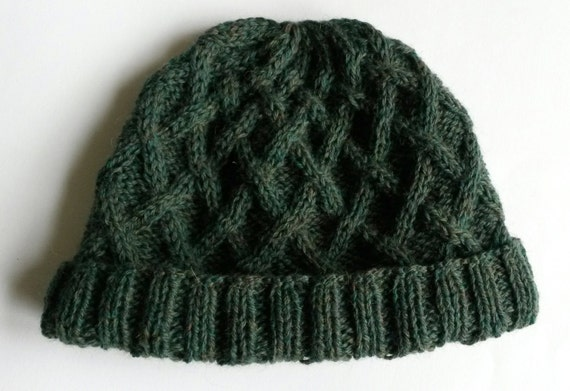 Aran Fisher Beanie: handknit cabled hat in 100% wool. Natural fibres, cosy yet lightweight. Original design; green wool. Timeless style.