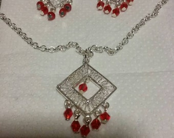 Red crystal and silver necklace and earrings set