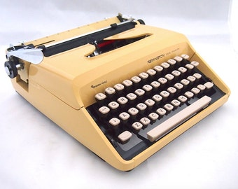 Remington Sperry Rand 10/40 ten forty typerwriter, 1960's typewriter, yellow typewriter, including case, portable, working typewriter.