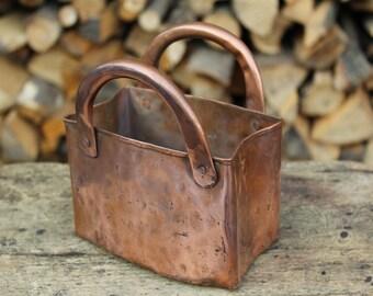 Copper handcrafted handbag storage jar