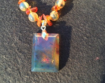 Blue Dominican amber necklace with Baltic amber accents and blue rectangle pendant
