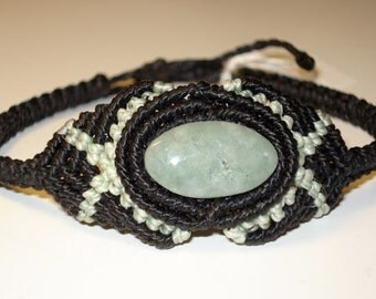 Bracelet with a green Jade, black and light green, macrame
