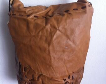 Brown large shoulder bag on a long strap, a bag made of genuine leather.
