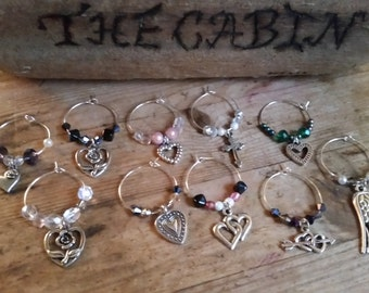 gorgeous delicate glass charms for any occasion made with antique silver charms, crystals, pearls, swarovski and and semi precious stones.