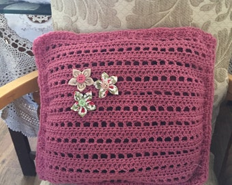Decorative cushion with flower detail