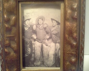 Reduced...Lost relatives....3 cowboys postcard in wood frame and glass