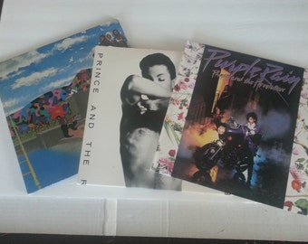 Three Vinyl LPs by Prince Purple Rain,Around the World in a Day Trifold,Parade