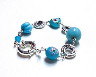 Bracelet made of glass and ceramics (blue and pink)