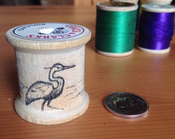 Vintage thread spool with hand drawn heron
