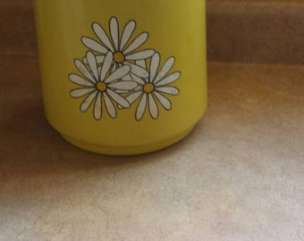 Retro Mustard yellow Daisy cookie tin.