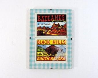 Framed vintage water decals of Badlands and Black Hills South Dakota