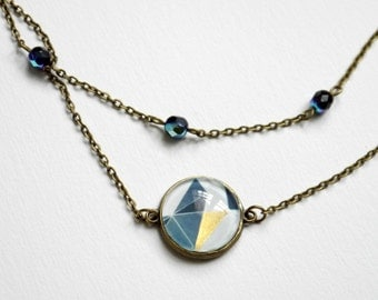 Necklace 2 ranks in bronze with black cabochon geometric pattern grey, black and gold, and Pearl of Bohemia with a blue Sheen