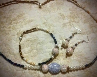 Necklace, bracelet and earrings to match