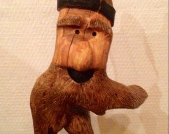Old bearded wood carving