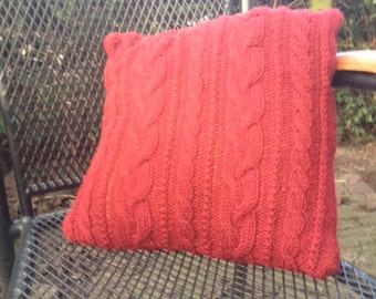 Hand knitted wine red pillow with cables