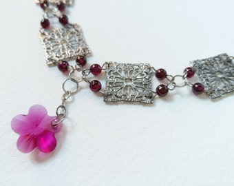 Unique necklace with garnet & purple crystal pendant