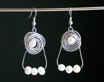 Earrings swirl and four pearls