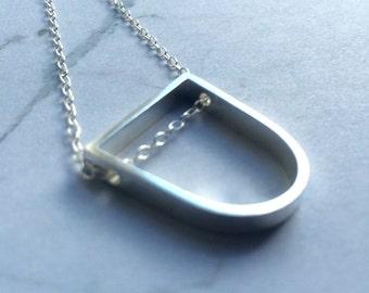 Geometric D shape Sterling silver chain necklace. Horse shoe, stirrup shaped pendant. Minimal, simple, polished,