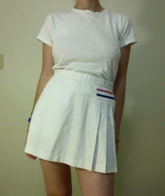 white pleated tennis skirt made by le coq sportif