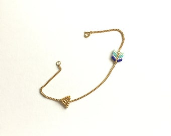 Bracelet arrow weaving Japanese beads and golden chain.