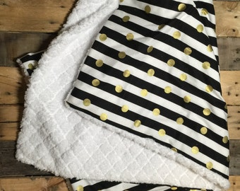 Black, white, and gold baby blanket