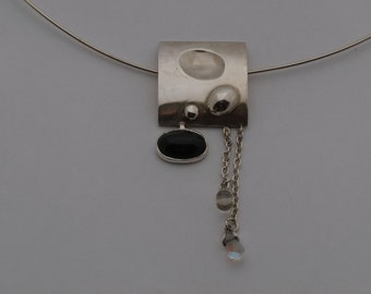 silver necklace with obsidian and earrings
