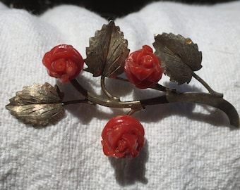 Coral and silver brooch
