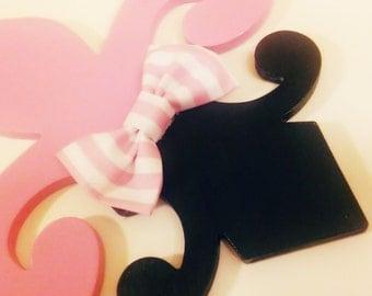 Pink and black fluer de lis