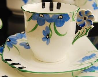 Flower handle art deco tea cup trio