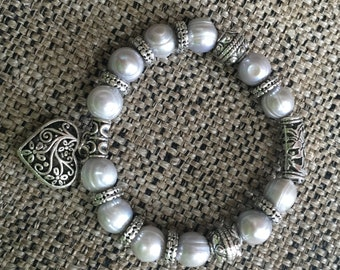 Pearls cultured with silver