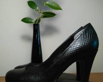 Black mock snakeskin pumps