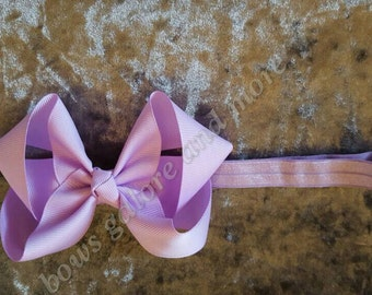 Beautiful lilac/orchid baby streachy elastic headbands. Boutique twisted bow style. 4inch x