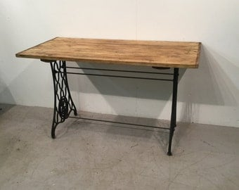 Custom made industrial table on cast iron base