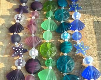 Handmade Lampwork Glass Beach Shell Mix Collection, 8 inch strand