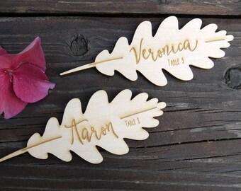 10 + place cards, name badges, table cards in the oak leaf design, engraved on wood