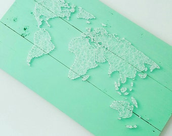 Self catering in String Art world map on scrap wood!