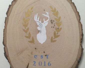 customized wood slab with deer silhouette