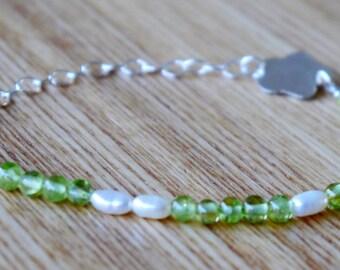 Peridot, freshwater pearls, handmade sterling silver charm, sterling silver chain bracelet