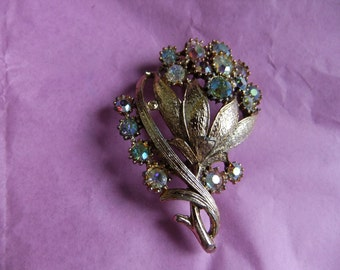 Vintage brooch flower design claw settings pale rhinestones