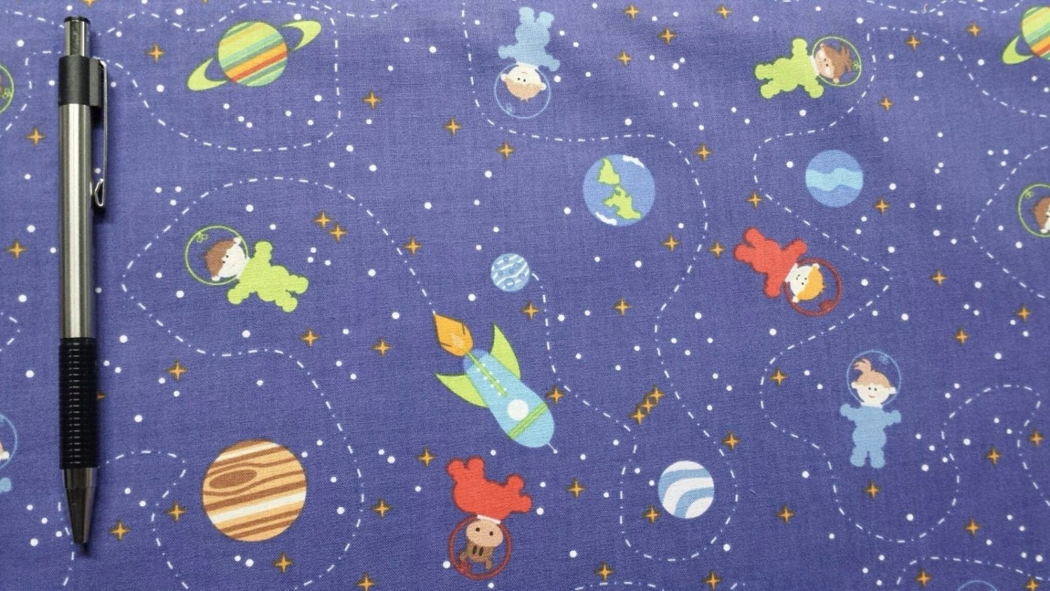 Clothworks space age dark purple 100 cotton 43 fabric by for Space fabric by the yard