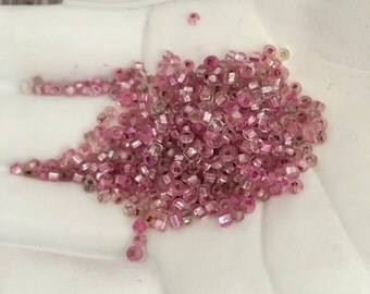 27g of 11/0 Shiny Metallic Pink Seed Beads
