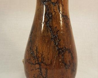 turned vase with burned pattern