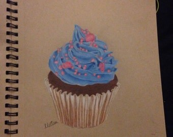 Chocolate cupcake with blue frosting and pink sprinkles