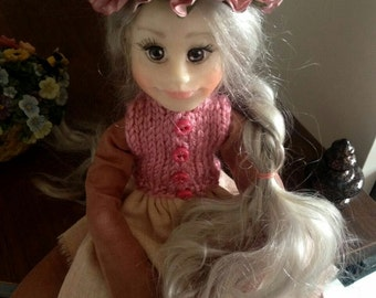 Doll with pastel rose