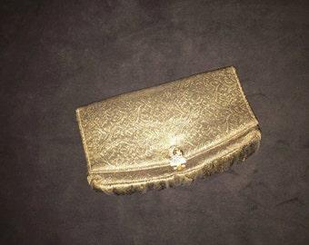 "Vintage small gold ""Garay' clutch"