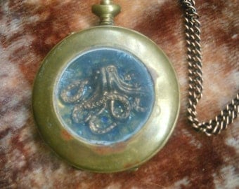 Octopus in pocket watch necklace