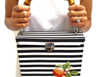 Black and white embroidered fabric case with a bamboo handle, lemons and oranges bag
